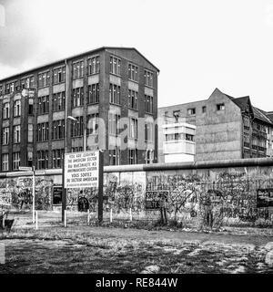 August 1986, leaving American sector warning sign, Berlin Wall graffitis, East Berlin watchtower, Zimmerstrasse street, West Berlin, Germany, Europe, - Stock Photo