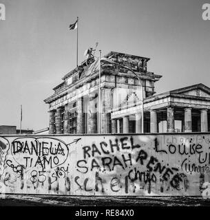 August 1986, graffitis on the Berlin Wall and Brandenburg Gate in East Berlin, West Berlin side, Germany, Europe, - Stock Photo