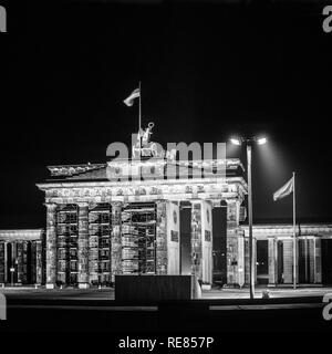 August 1986, illuminated Brandenburg Gate at night in East Berlin, view from West Berlin side, Germany, Europe, - Stock Photo