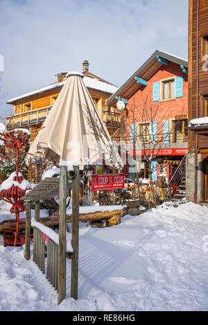 The Lovely Le Coup De Coeur Wine Bar and Restaurant in the Centre of Morzine with Winter Snow Haute Savoie Portes du Soleil France - Stock Photo