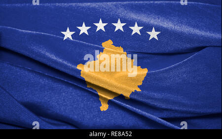 Realistic flag of Kosovo on the wavy surface of fabric. Perfect for background or texture purposes. - Stock Photo