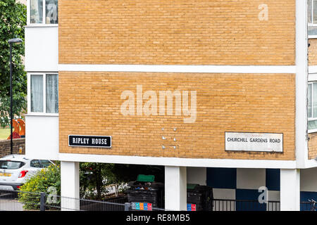 London, UK - June 21, 2018: Churchill Gardens neighborhood road closeup in Pimlico with old vintage historic traditional style flats buildings in summ - Stock Photo