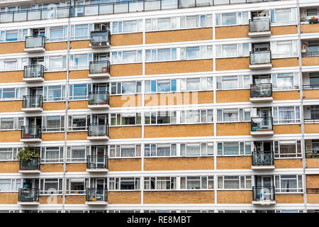 London, UK Churchill Gardens neighborhood closeup in Pimlico with old vintage historic traditional style flats apartment buildings in summer cheap hou - Stock Photo