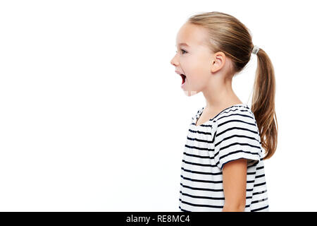 Cute little girl in stripped T-shirt talking. Speech therapy concept over white background. - Stock Photo
