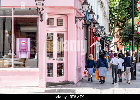 London, UK - June 21, 2018: Neighborhood district of Victoria or Pimlico with pink color vibrant colorful restaurant building for Sakuya Japanese food - Stock Photo