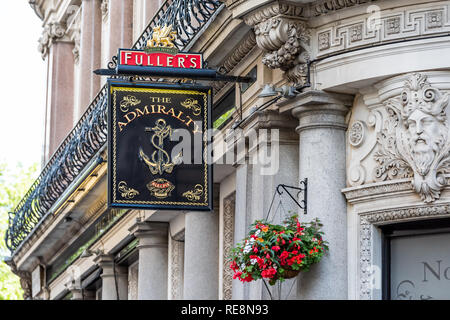 London, UK - June 21, 2018: Closeup of famous Admiralty pub bar with entrance and nobody red Fuller's sign by Trafalgar Square - Stock Photo