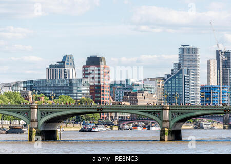 London, UK - June 21, 2018: Cityscape skyline and green Westminster bridge on Thames river during sunny summer day, modern buildings - Stock Photo