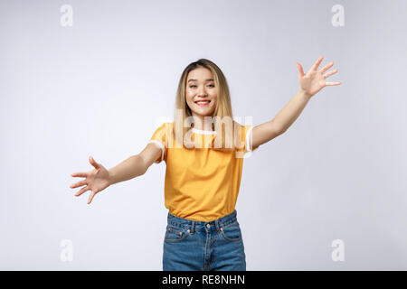 Closeup portrait of pretty young woman motioning with arms to come and give her a bear hug, isolated on white background. Positive emotion facial expression feeling, signs symbols, body language. - Stock Photo