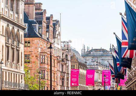 London, UK - June 22, 2018: Royal Academy of Arts institution at Burlington House on Piccadilly Circus with Arcade nobody and pink banners advertising - Stock Photo