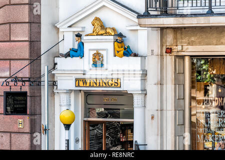London, UK - June 22, 2018: Closeup of Royal Twinings tea store building sign exterior with nobody center of downtown district city with old architect - Stock Photo