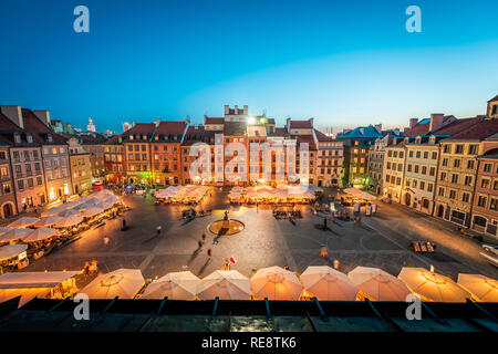 Warsaw, Poland - August 22, 2018: Historic cityscape with high angle view of architecture rooftop buildings and dark sky in old town market square at  - Stock Photo