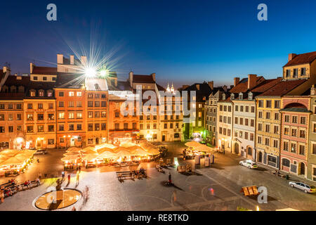 Warsaw, Poland - August 22, 2018: Cityscape with high angle view of architecture rooftop buildings restaurant and dark sky in old town market square a - Stock Photo