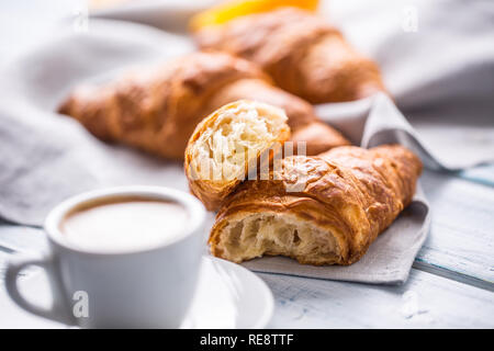 Fresh buttery croissants with coffee. Sweet morning breakfast concept. - Stock Photo