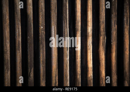 Corrugated iron, painted black, full frame backdrop with subtle winter sunlight. - Stock Photo