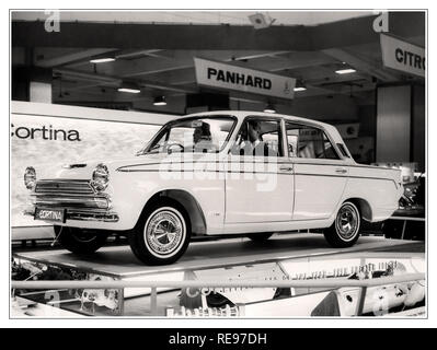 Ford Cortina motorcar at the 1964 Earls Court Motor Show The Ford Cortina Mk 1 was first on sale in 1962 and was voted car of the year in 1964. - Stock Photo