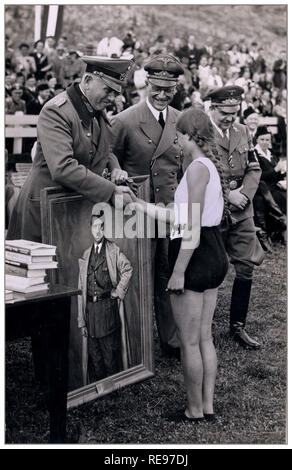 Archive Sports Day in Holland with Nazi Officers handing out the prizes Lieutenant General Otto Schumann commander-in-chief of the Ordnungspolizei in the Netherlands, Reich Commissioner Arthur Seyss-Inquart and General Commissioner Fritz Schmidt. General Schumann hands a sportswoman a portrait of Adolf Hitler as a prize. 21 July 1941 - Stock Photo