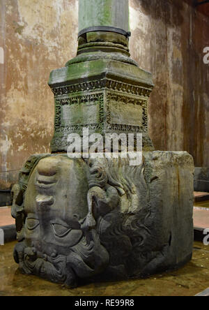 Re-purposed, ancient, Medusa head supports a column once covered by water in the vast, underground Basilica Cistern, Istanbul, Turkey, Europe. - Stock Photo