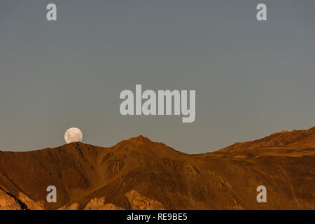 Full Moon rising over the Andes mountains, Esquel, Patagonia, Argentina - Stock Photo