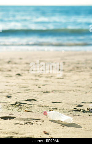 Pollutions and garbages on the beach - Stock Photo