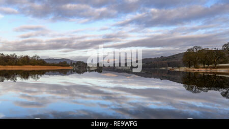 Looking up Esthwaite Water near Hawkshead to the fells in the distance on a cold, still, frosty winter morning - Stock Photo