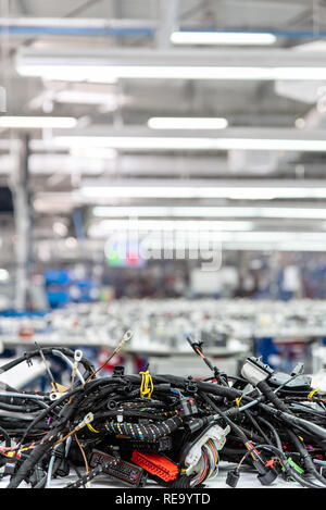 Manufacturing of wiring harnesses, automotive industry, technology - Stock Photo