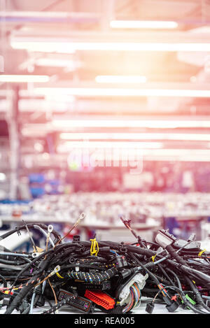 Wiring harnesses, technology. Automobile industry background - Stock Photo
