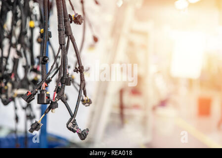 Bunch of wiring harnesses. Automobile industry background with copy space, light effect. - Stock Photo