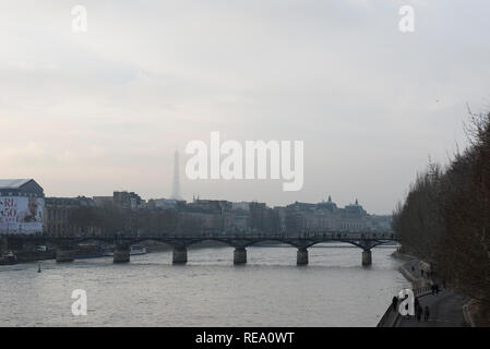 Overlooking the river Seine in Paris on a dull grey winters day. - Stock Photo