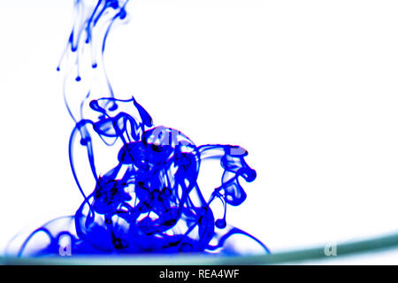 blue ink in water - Stock Photo