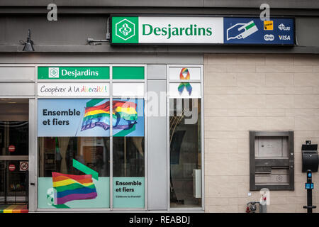 MONTREAL, CANADA - NOVEMBER 5, 2018: Desjardins Bank logo on their branch for the gay district le Village, with LGBT friendly slogan. Mouvement Desjar - Stock Photo
