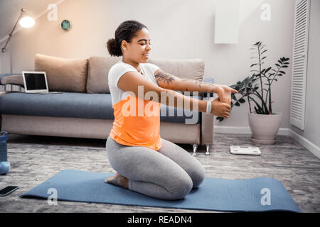 Smiling attractive lady being happy with her sportive routine - Stock Photo