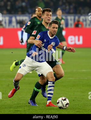 Gelsenkirchen, Germany. 20th Jan, 2019. Robin Knoche of Wolfsburg vies with Mark Uth (Front) of Schalke 04 during the Bundesliga match between FC Schalke 04 and Vfl Wolfsburg in Gelsenkirchen, Germany, Jan. 20, 2019. Schalke 04 won 2-1. Credit: Joachim Bywaletz/Xinhua/Alamy Live News - Stock Photo