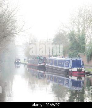 Kidderminster, UK, 21st January, 2019. UK weather: it's a misty, cold and damp day today with the sun struggling to break through the clouds. Temperatures are barely reaching 5 degrees and people in these narrow-boats are staying put and not venturing out today. Credit: Lee Hudson/Alamy Live News - Stock Photo