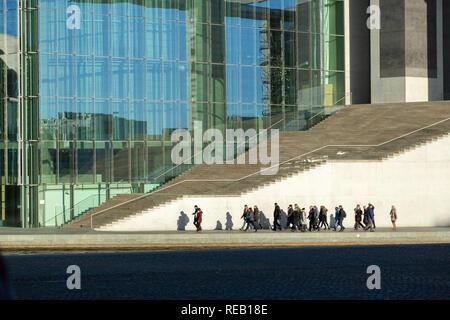 BERLIN - GERMANY - DCEMBER, 2018. People walks around Marie-Elisabeth-Lueders-Haus - modern building in Mitte district is part of Bundestag.