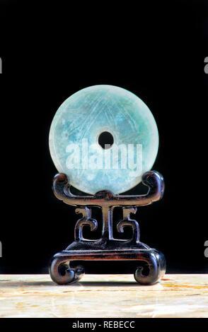 Chinese nephrite jade bi disk made in the 19th century. - Stock Photo