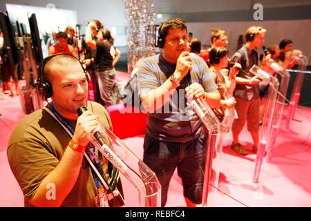 Sony PlayStation Singstar karaoke singing game, stand at the Entertainment Area of the Gamescom, the world's largest fair for - Stock Photo