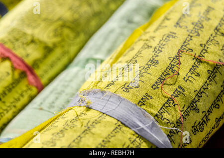 Close-up of rolled Buddhist prayer flags - Stock Photo