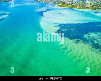 Incredible patterns and textures left by the sand with turquoise water glistening above. Pumicestone Passage, Sunshine Coast, QLD, Australia. - Stock Photo