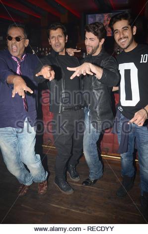 Singer Remo Fernandes, actor Vikram, Neil Nitin Mukesh  and Vinay Virmani during the music launch of upcoming film David in Mumbai, India on January 14, 2013. (Shripad Naik/ SOLARIS IMAGES) - Stock Photo