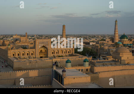 Khiva cityscape in sunset from tower of Itchan Kala, the walled inner town of the city of Khiva, Uzbekistan. - Stock Photo