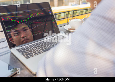 Investor watching the change of stock market on laptop. - Stock Photo