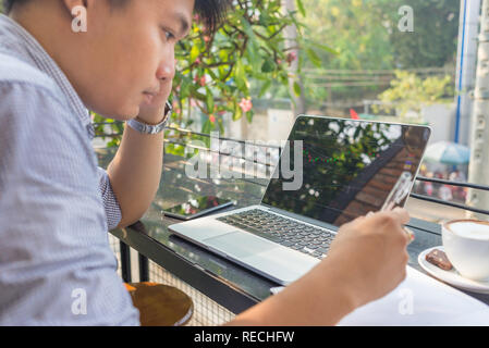 Investor watching the change of stock market on laptop - Stock Photo