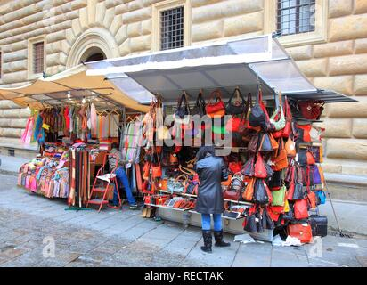 Market stall with Florentine leather goods in the historic center of Florence at the Palazzo Vecchio, Florence, Tuscany, Italy - Stock Photo