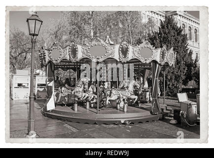Old fashioned french carousel with horses Vintage Monochrome photo - Stock Photo