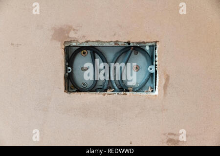 First fix domestic electrics in a freshly plastered wall. - Stock Photo