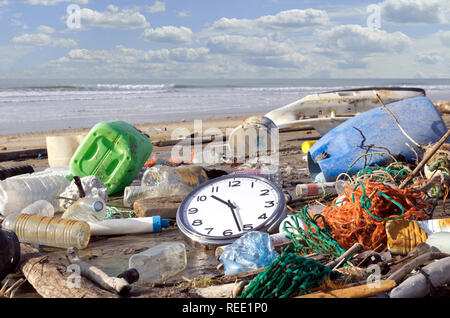 Trash beach pollution. Garbages, plastic, and wastes on the beach. Pollution: it's time to wake up! - Stock Photo