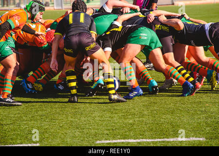 Valencia, Spain - January 19, 2019: Fight for the ball between players during an amateur rugby match. - Stock Photo