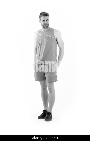 Sportsman in active wear and shoes for running isolated on white background. Bearded man in blue sport clothes and sneakers. Sport fashion style and trend. Training and workout activity. - Stock Photo