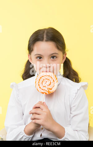 dieting. dieting and healthy food concept. dieting after dessert eating. small girl with lollipop doesn't like dieting. healthy life - Stock Photo
