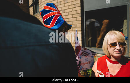 WINDSOR, UNITED KINGDOM - MAY 19, 2018: Senior woman with funny UK Union Jack hat during royal wedding marriage celebration of Prince Harry and Meghan Markle  cinematic color   - Stock Photo